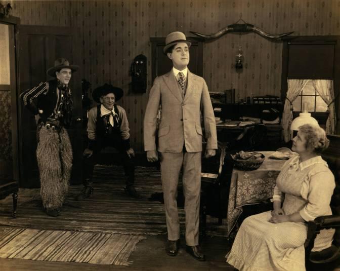 A film still from Betzwood featuring John Keenan, Louis Bennison and an unknown woman.